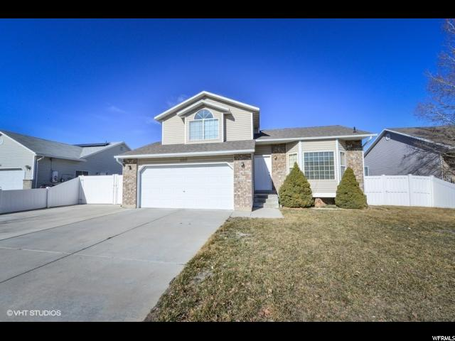 单亲家庭 为 销售 在 6160 W DEER SPRINGS Lane 6160 W DEER SPRINGS Lane Kearns, 犹他州 84118 美国