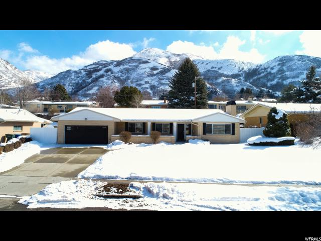 Home for sale at 1423 S Canterbury Dr, Salt Lake City, UT 84108. Listed at 699000 with 5 bedrooms, 3 bathrooms and 3,562 total square feet