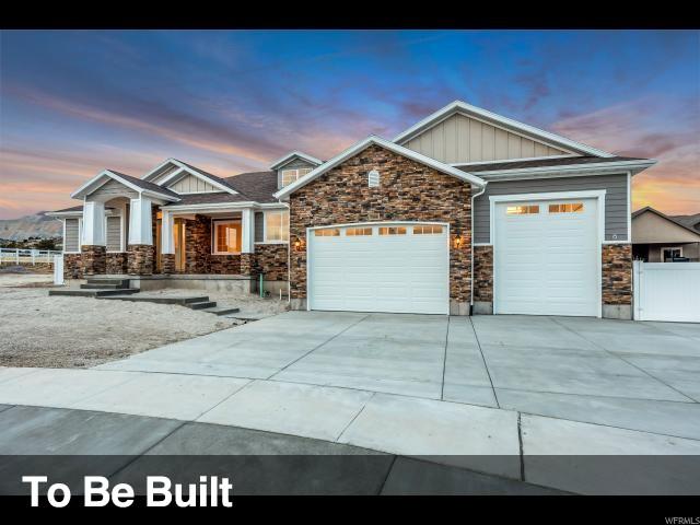 Unique la famille pour l Vente à 7833 N COBBLEROCK Road 7833 N COBBLEROCK Road Lake Point, Utah 84074 États-Unis