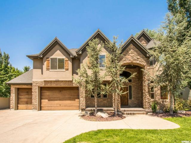 Home for sale at 4732 S Hiddenwoods Ln, Murray, UT  84107. Listed at 740000 with 5 bedrooms, 4 bathrooms and 4,812 total square feet