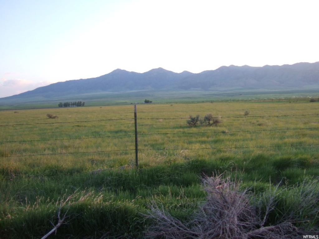 Property located approx 5 miles NW of Malad. Beautiful view of mtns. Land in CRP. Good stand of grass pasture. Nice quiet area of Malad Valley. Graveled road. Additional land 40 acres available for $120,000. CRP contract to be honored. Oil/mineral rights excluded. Ground may need to be surveyed.