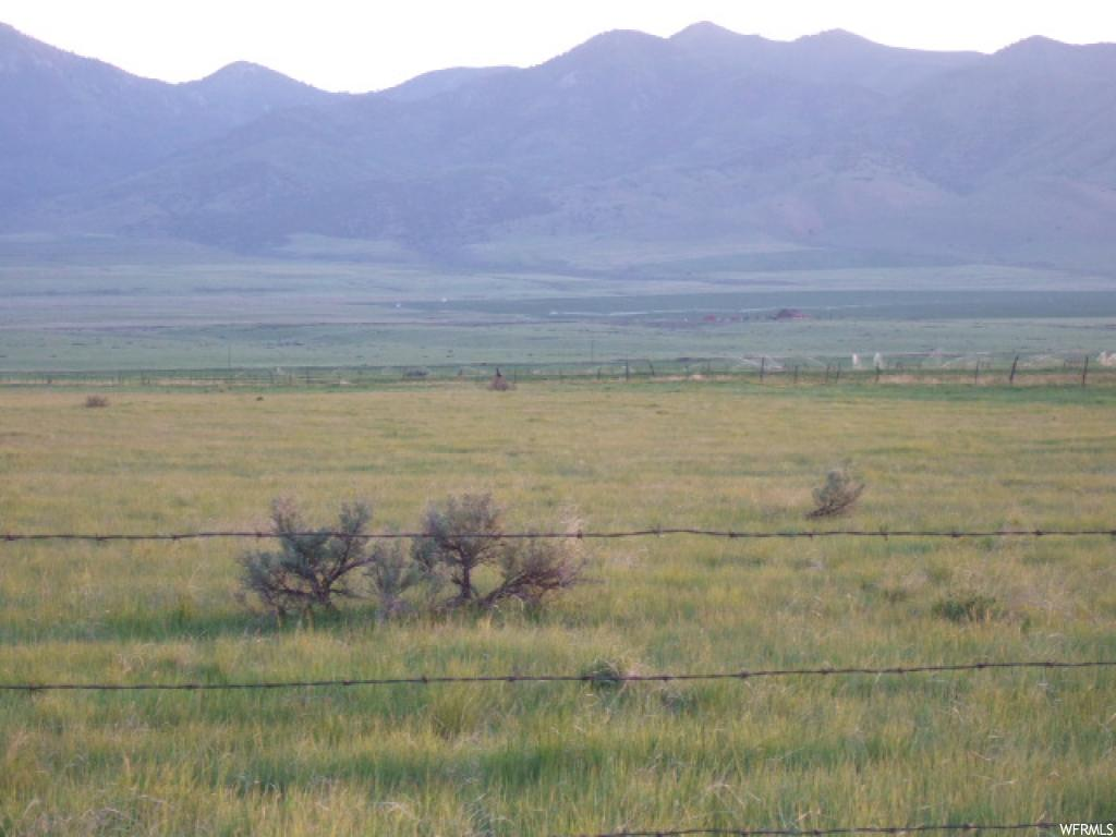 Property located approx 5 miles NW of Malad. Beautiful view of mtns. Land in CRP. Good stand of grass pasture. Nice quiet area of Malad Valley. Graveled road. CRP contract to be honored. Oil/mineral rights excluded. Ground will need to be surveyed.