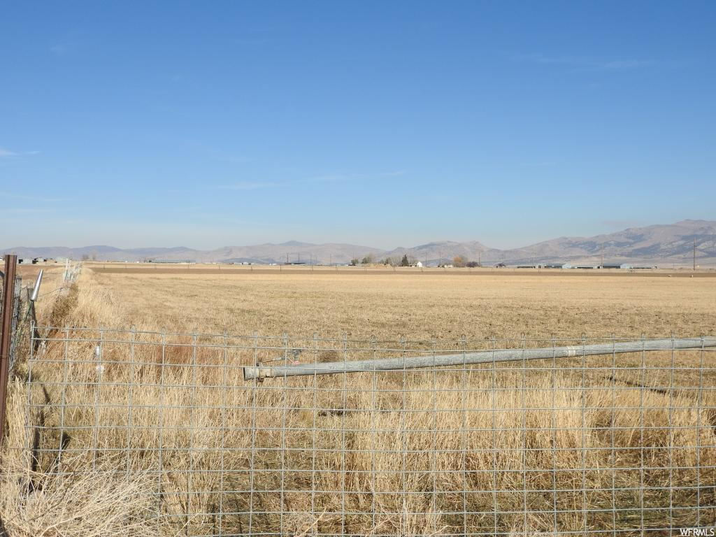 Located in Freedom. Additional tax id: 25039X 25040, 25046, 25047, 25048. Folks, if you're looking for farm ground that has it all, this is the piece.  This property has irrigation water shares, hay crop, wheel irrigation lines, corrals, livestock holding chutes, excellent area to build your ranch house and an old pioneer house that needs lots of work, beautiful views of the valley and mountain ranges and highway frontage on two sides, located in beautiful and quiet Freedom, Utah. Buyer to verify all information.