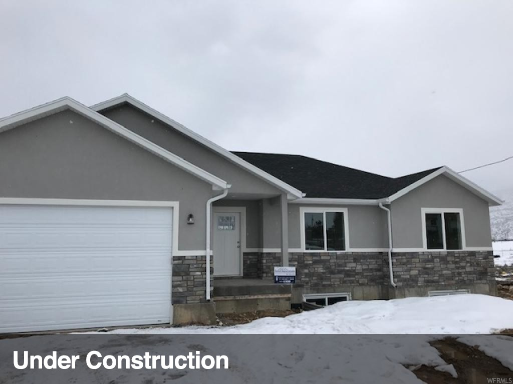Brand new home built in a beautiful location. A great view on the Sanpete valley and mountains. Just a few blocks away from fountain green elementary school. 15 minutes from I 15 freeway. This home sits on a half acre lot that has a great walk out deck view. 3 bedrooms with many upgrades including custom cabinets and countertops, master bathroom has separate tub and shower, stainless steel appliances and a gorgeous walk out deck.