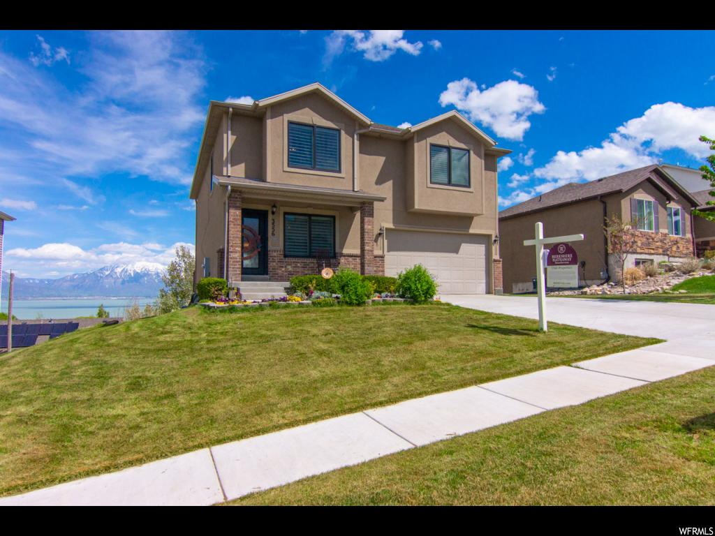 Includes a one year Home Warranty. GREAT VALUE!  Fully finished 3811 sqft, 5 Lrg Bedrooms, 3.5 Baths, with stunning & unobstructed views of Valley, Lake & Mountains.  Open & spacious Great-room. with walk-out Family Room, Bedroom &  Bath in basement.  It sports a beautiful a custom iron front door ($5000),  Anderson windows, plantation shutters, generous wainscoting, fresh pain, light fixtures, crown moldings and trim, HUGE pantry, double decker deck, large closets, full exterior stucco, custom workbenches and overhead storage in garage.