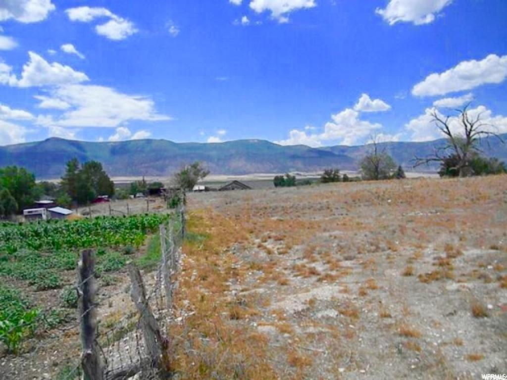 #1 Now Pre-selling  Build-Ready Lots!  3 lots just under 1 acre each  with a great view over the valley and mountains. All utility connections stubbed at the road. Ready by early spring.  Build your home here in the quiet town of Moroni.  Buyer to Verify all info provided by county records.