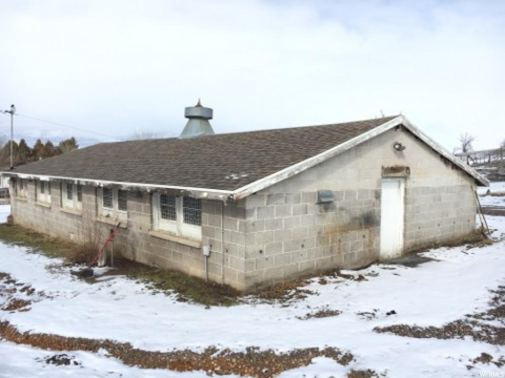 Pre-selling Build-Ready Lot with a 60x30 Shop with power already built on over 1/2 acre! All utility connections stubbed at the road. Ready by early spring for Building. Build your home here in the country town of Moroni. Buyer to Verify all info provided by county records.