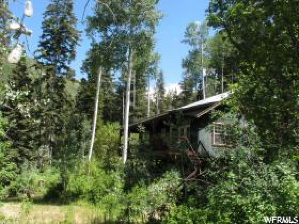 "Mountain cabin on 3.4 acres in the Manti La Sal Mountains in Northern Sanpete County. Property consists of 5 Lots in Aspen Hills being Lots 1020, 1021, 1040, 1041 & 1042. Property is located high in the mountains in a beautiful setting with large Pine and Aspen trees. A year round stream is just off the property in the valley below. Cabin has a large 300 sq ft covered deck in front that provides a beautiful view of the valley. This is a gated community - contact listing agent to borrow a key or for a showing of the property. GPS Coordinates: 39°34'30.9""N 111°21'16.7""W. Elevation 7,851"