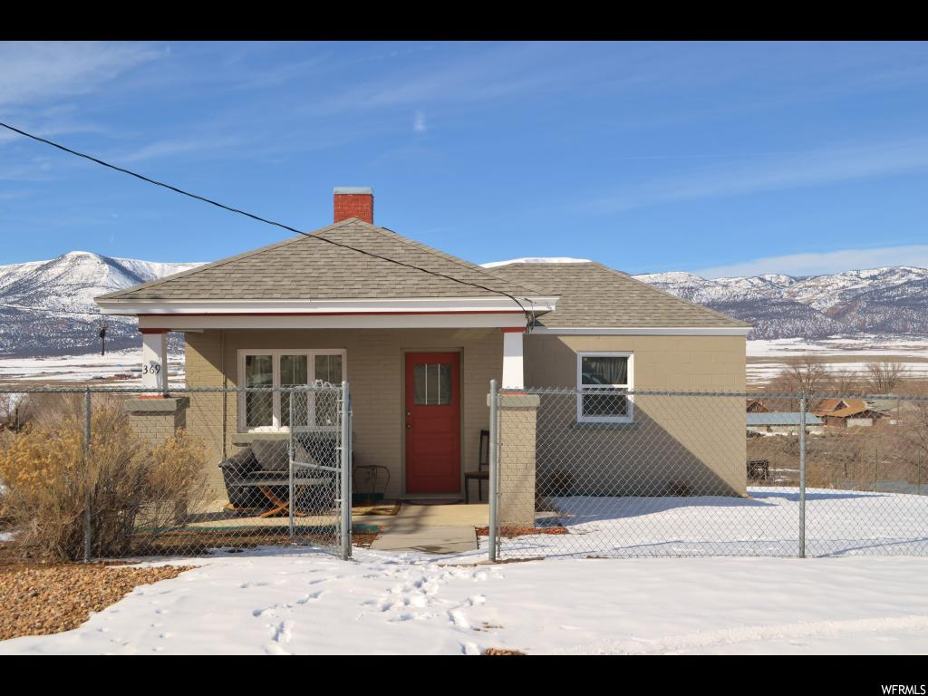 You don't want to  miss this beautifully remolded 1 bed 1 bath home.  Don't let the square footage fool you. Only 1.5 hours from Salt  Lake, this home is cozy with a great layout that utilizes its space well! The master bedroom, with walk in closet, is quite large and easily accommodates a queen bed with a dresser leaving room to spare  This home has new 30 year laminate flooring, new roof, new furnace, new water heater and updated electrical and plumbing. This would be perfect for a starter home, or a weekend getaway for anyone who loves to trail ride, hunt or fish or just get out of the city for awhile. With the huge yard space , and drive through gate it would be easy to store ATVs or other outdoor toys!  Bring your RV, and use the outdoor hook-ups to add more space on your weekend adventures. If you are looking for a peaceful, scenic place to call home, this is it!  The yard is fully  fenced with a front gate that can be locked for privacy.    There is an outbuilding/ shed , that has power and lighting.  The shed has been fully finished as well.  This is a must see home, turn key ready!