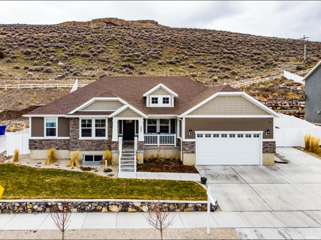 This beautiful rambler is situated in a great location away from the busyness of Northern Utah County but still close to everything! It is walking distance to the elementary school and many parks in the neighborhood. Enjoy not having backyard neighbors. The hillside behind provides a beautiful backdrop to the home and yard making it feel even more quiet and peaceful. Boasts attractive landscaping that maximizes all of the usable yard space. Large bedrooms and fantastic open concept floor plan with a spacious great room make it excellent for family and entertaining friends. Many other desirable features include: quartz kitchen countertops; nice pantry; tray ceiling in master bedroom; and grand master bath with separate tub & shower. Must see!