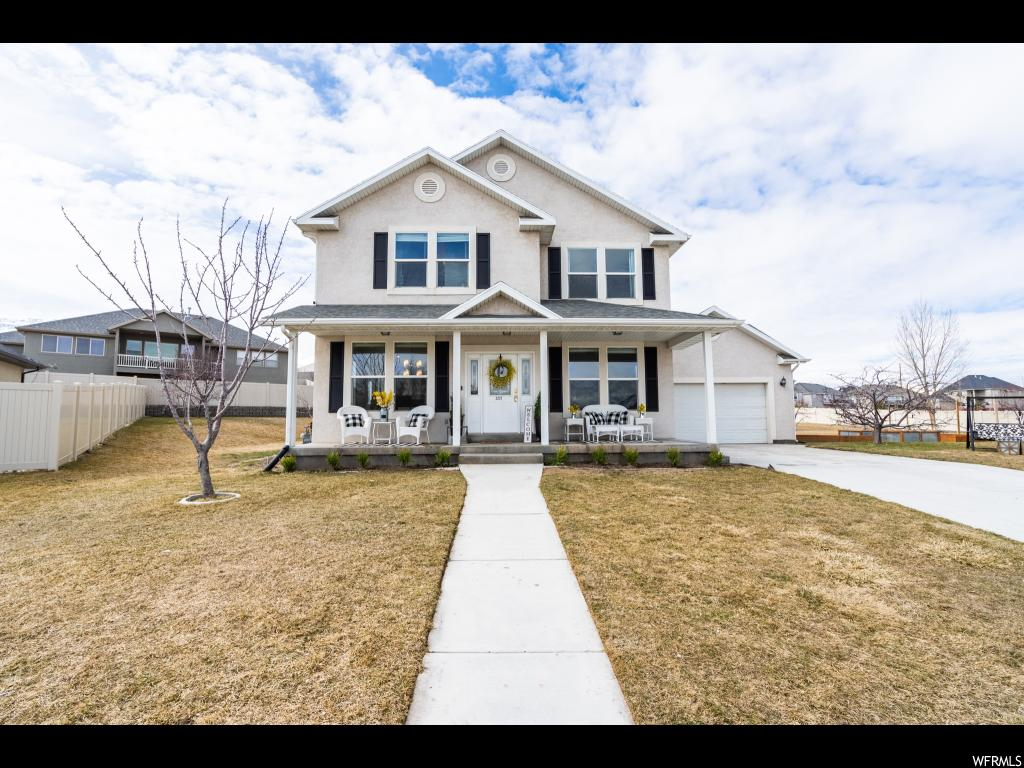 GRAND OPEN HOUSE Saturday, March 16th, 1-3 pm. BE SURE TO CHECK OUT THE TOUR BUTTON AT TOP PAGE! Fall in love with this delightful 2 story, turn-key home on a wonderful cul-de-sac in a spectacular neighborhood! This 6 bed, 2.5 bath with a two-car garage is on 0.492 acres, giving you 4,082 sqft of spacious elegance to accommodate all of your hobbies and passions, and an expansive, partially-fenced yard for all of your outdoor needs. No detail was missed inside this home with new flooring throughout, remodeled bathrooms and a stunning modern, gourmet kitchen with quartz counter-tops. There are 2 furnaces, 2 water heaters and 2 AC units installed to ensure that your family never runs out of heat, hot water or air conditioning. Let the beautiful mountains and gorgeous view of Utah Lake draw you outside, where there's plenty of space for your family to relax and have fun together, including a 60' x 30' basketball court in your own backyard! Enjoy the mature fruit trees on the property and grow anything your heart desires in your own custom, garden boxes. Imagine cuddling up to a cozy fireplace with a good book to drift off to sleep and then wake up to a spectacular sunrise over the lake. All of this situated in a convenient, friendly neighborhood with outstanding schools, only minutes from Pioneer Crossing. Don't let this dream home slip through your fingers. Buyer to verify square footage.