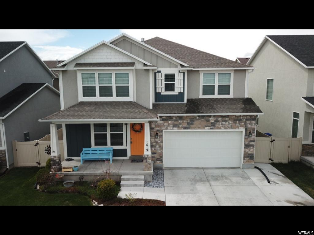 **MUST SEE** Stunning home located in the beautiful River Heights subdivision. Upgrades throughout. Tile bathrooms. Upgraded/over-sized cabinets. Custom woodwork. Finished basement with play area. In wall 7.2 surround sound TV room. Gas fireplace ready. You will fall in love with this home.