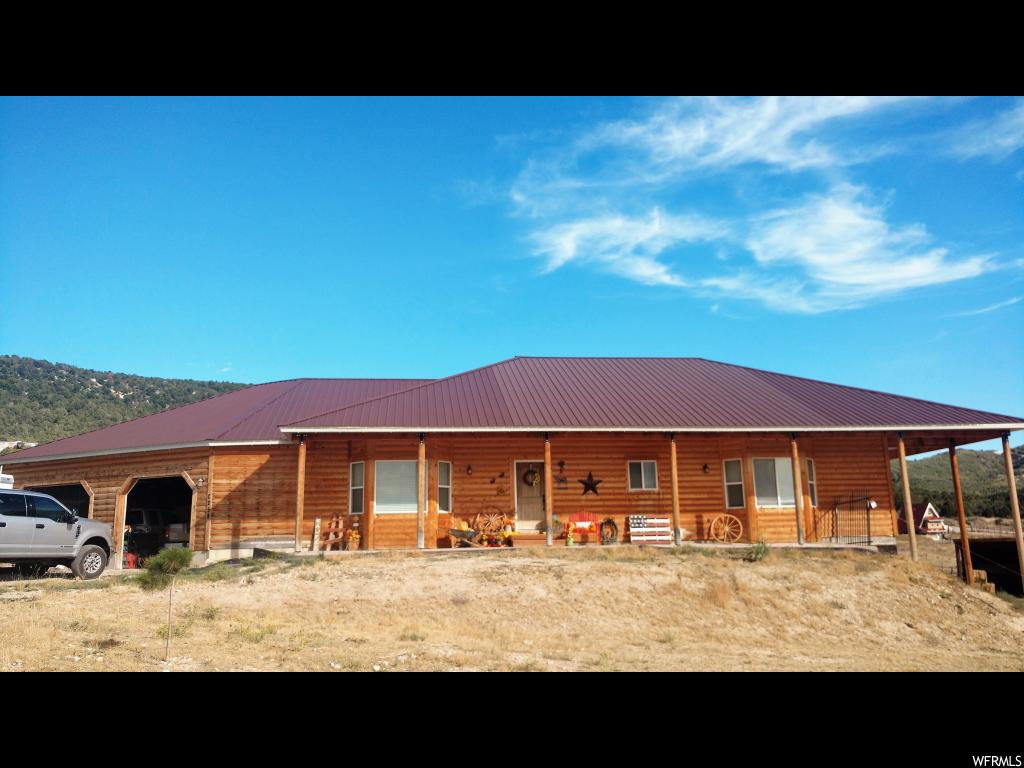Half log siding w/ covered front&back porch sitting on 2.96 acres of Horse Property.Open Rambler Plan,2x6 Walls,Vaulted Ceilings,9' Basement Walls,Great Room,Spacious Kitchen,Mudroom,Laundry Room upstairs. Huge Garage with Hot/Cold water lines,gas line,large workbench area&space to park ATV's. Pole Barn w/electricity&water spicket. Property has lots of parking/storage space, room to grow. Close proximity to camping,hunting,riding trails&riding tracks. 30 minutes from Spanish Fork.  Square footage figures are provided as a courtesy estimate only.  Buyer is advised to obtain an independent measurement.