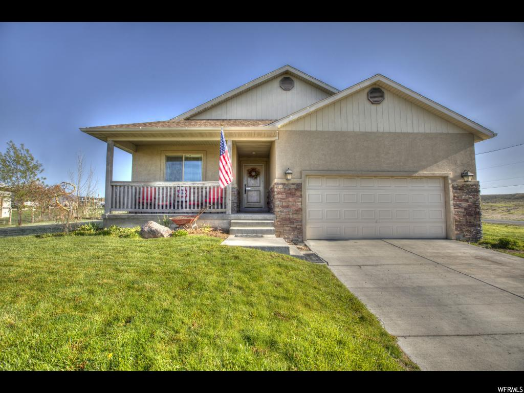 A beautiful custom built home.... just want you have been looking for! Inviting entry way with a grand staircase. Nice open floor pan.  Beautiful wood floors throughout. Master bedroom has a large walk in closet. Lovely master bath with separate tub and shower. Kitchen has concrete counter tops and stainless steel appliances. The downstairs is finished beautifully with a large family room with plenty of space for large gatherings. Don't forget the awesome back yard with a full automatic sprinkler system and a 14X12 patio. You don't want to miss out on this great home!  Square footage figures are provided as a courtesy estimate only and were obtained from ______________ .  Buyer is advised to obtain an independent measurement.