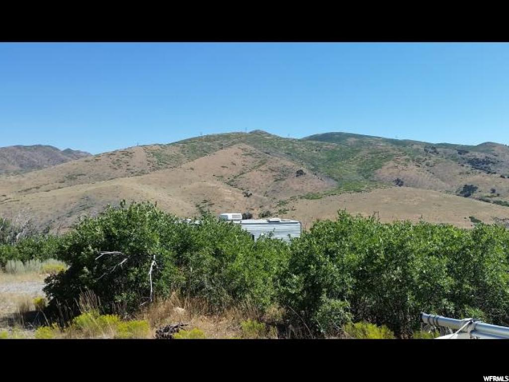LOOKING FOR A PERFECT GETAWAY??  10 ACRE LOT  IN HOLIDAY OAKS ESTATES, APPROXIMATELY 7 MILES EAST OF NEPHI.  BEAUTIFUL VIEWS,  PEACE , TRANQUILITY AND CLEAN FRESH MOUNTAIN AIR!!   THE MAIN GATE IS LOCKED AND MUST BE SHOWN BY APPOINTMENT ONLY.   THE SALE INCLUDES A MASSEY-FERGUSON BACKHOE AND A GAS ENGINE CEMENT MIXER.  GREAT BUY!