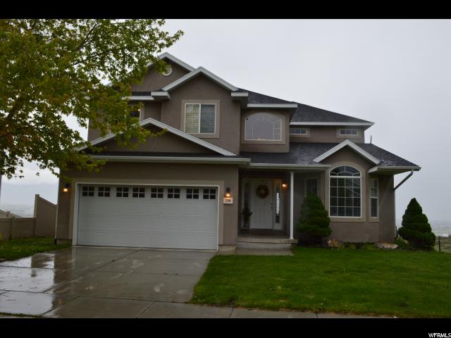 Have you seen the amazing view from the deck? You can see the entire valley and host on the huge deck. This home has new carpet, Grand living spaces, GRAND master suite with double sinks in the master, jetted tub and more. 100% finished basement with theater, game room, & large bedroom.