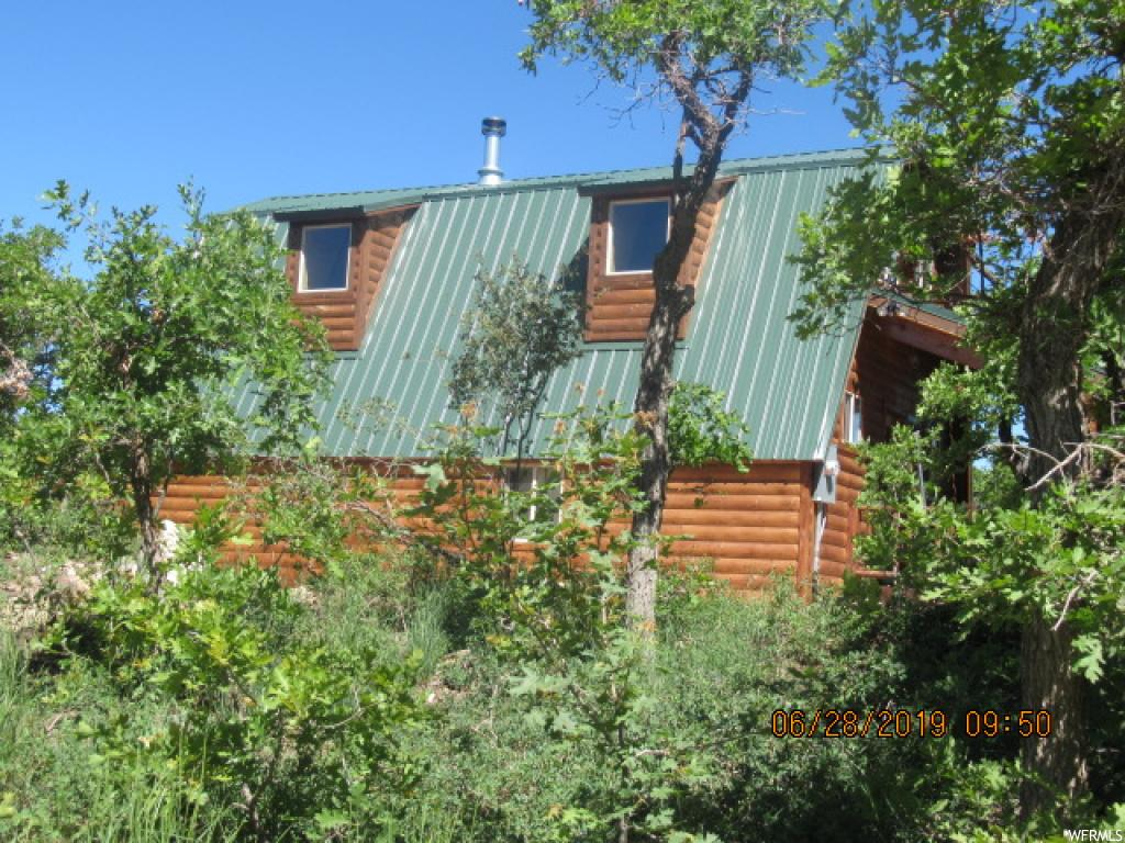 Beautiful Cabin that has been all redone!!  Located on a larger lot (2.3 Acres) with Incredible Views. New upgrades including – new structural sheer walls before adding T&G was added, new metal roof, new flooring (LTV wood & carpeting), electrical, plumbing,  windows (Low E & Insulated), large exterior water tank (1750 gallons), septic tank and drain field, new exterior log paneling (not panel siding), new T&G and log paneling inside, added insulation in exterior walls and ceiling), lights, new decks w/log railings, new fireplace and flues, new electric water heater, new cabinets, granite countertops, toilets, faucets, shower, tub, sinks, heated plumbing wrap in crawl space for winter use, new surround sound and low voltage pre-wiring, high definition antenna for TV, new gravel in half round drive,  bistro lights on front porch, security motion sensor lights.  When upgrading the cabin - the sellers took NO building permit to do these upgrades- improvements.  The reason is because we treated these changes as 'upgrading and improving' the existing cabin and not as 'a remodel'.   We did have an county building inspector who happened to be driving by stop and come in (when we were underway) and asked that question – 'are we remodeling or improving' and we explained improving/upgrading which is a fine line.  Anyways for any technical improvements/upgrades we used only licensed subs to insure it was done correctly.  I.e. - Mt Pleasant Power did do the power inspection when they connected the new meter.  Seller want to disclose this so there's no issue.  There is no warranty – Sellers are selling it 'as is.'