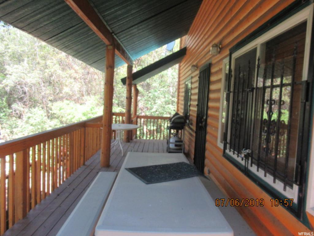 Beautiful log sided cabin on Birch Creek.  Year around stream with fish in it.  Two lots for added space and privacy.  Cabin has vaulted ceilings, pellet stove, Bedroom on the main floor with 2 bedrooms up.  Family room up and down, 3 decks. Cabin comes fully furnished except for a few items listed in the agent remarks.  Detached oversize 1 car garage. Washer and Dryer hookups in the garage.  HOA includes a swimming pool, tennis courts, golf course, play ground etc.  Excellent opportunity to own a cabin on the creek.