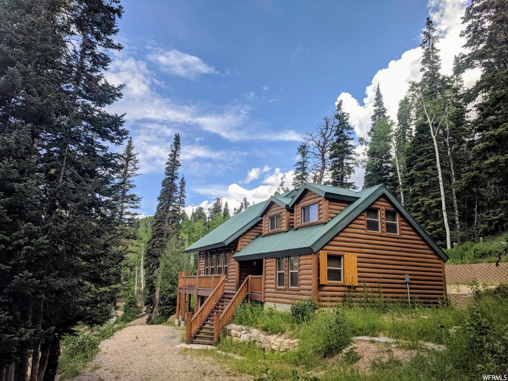 Like NEW furnished log cabin, NO HOA on 20 acres of mostly useable land with pines, aspens bordering the National Forest just 7 miles north on Skyline Drive from the top of Fairview Canyon. Hundreds of miles of ATV trails right out the front door. Go 2 miles North East to the C canyon primitive area. Many lakes, streams all around you. Sunsets, clean crisp air, wildlife, SECLUSION, private and quiet. Gas is propane, water from the developed spring that never dries up, power from the propane generator, solar panels-new 2012 and batteries-new 2019. The 1,000-gallon propane tank is owned and was last filled about 6 years ago and is down to 50% after 2 or 3 weeks of usage each summer. Propane generator was new about 7 years ago. The 20ac is made up of two 10 acre lots. Features: Knotty pine cabinets; one piece Corian countertops; porcelain tile floor; triple sanded aspen tongue and groove on the walls and ceiling; stub for BBQ; solar/battery-powered lights at each outside door; propane water heater and large fridge; oversize Trex deck; two 1,000 gallon water storage tanks; text from cabin; cell service close by; a booster would most likely give you strong internet in every room; new LED lights 2018; 20x18 bunkhouse with lights & loft; wood shutters for outside the windows. Winter access is by snowmobile.  Elevation 8,842 ft. MLS map is correct. Google Earth and Maps are 39.753707, -111.338985 Buyer to verify all information.