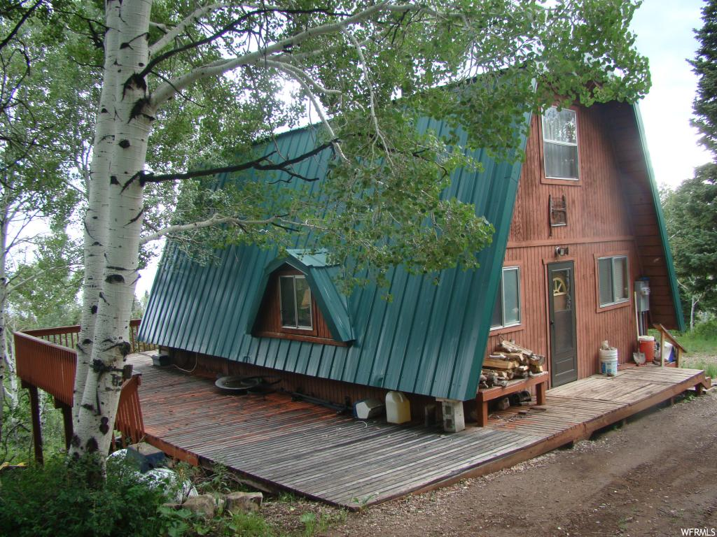 Cabin at the top of Skyline Mountain Resort. Beautiful view of the mountains & valley from the 655 square foot deck on the North East, and South sides of the cabin. One bedroom and bath on the main floor and 2 loft with one bedroom and additional living area. Tile and carpet flooring, granite, tile kitchen counter, Power connected, septic tank installed, water tank and pump, most furnishings included. 9'X19' basement room with gravel floor for storage. water well 560 feet away for easy water hauling.