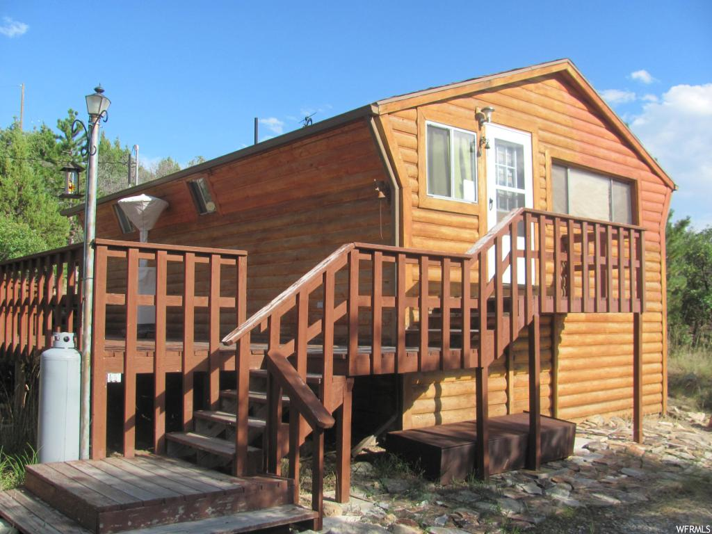 """Rare opportunity for affordable cabin with year round access, power and water onsite. Large 1.91 acre lot gives you plenty of room to expand or just enjoy nature from your modest cabin and wrap around deck. Large detached garage for all your toys. Ready for your personal touch. Priced for a quick """"as-is"""" sale. Map point is correct. Complete with community pool, tennis court, golf course of club house. Incredible getaway within a reasonable distance from the Wasatch Front."""