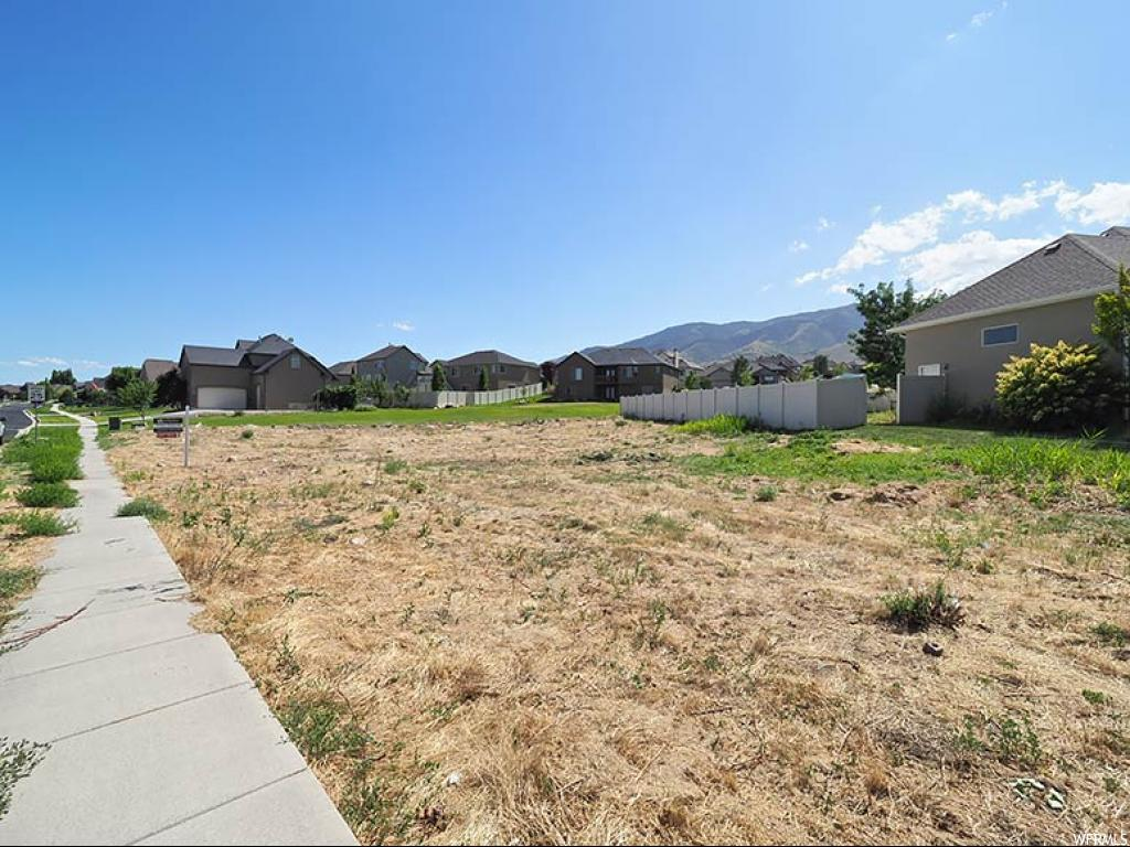 Build your DREAM home on this quarter of an acre lot in the heart of Joshua Ranch in Saratoga Springs. Minutes away from Utah Lake! All utilities are stubbed to property! AGENTS - READ AGENT REMARKS BEFORE SUBMITTING AN OFFER.