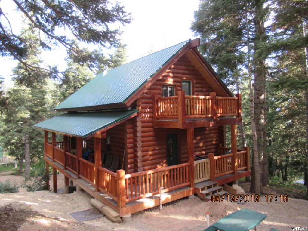 "Beautiful Cabin nestled on a pine covered lot.  Three decks take advantage of the surroundings!  10"" swedish cope logs.  Aspen tongue and groove ceiling.  Cabin has been completed in the last 2 years and shows great!!!   Wood burning stove.  10x20 garage for your snowmobiles or atv's.  Sq.ft. as per county assessor.  Buyer and Buyers agent to verify all information."