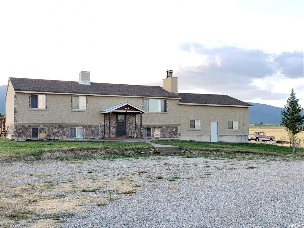 "*~*~*~*RANCH/HOME 6 bed/3 bath with acreage!!!  You can enjoy quiet country living and majestic mountain/valley views with many updates inside and out.  County maintained road; plenty of space to grow large garden, pasture, livestock property.   Just 60 miles to Provo, property located within Sanpete County 1 mile from Historic Spring City center/limits.  Within the ""buffer zone"" for possible/further subdividing into 1 acre lots, subject to appropriate approvals.  Culinary well and pressurized irrigation; septic; propane.  Main floor features 3 bed/2 bath; kitchen; living room; finished basement with 3 bed/1 bath; large family room; wood stove; laundry room; private mud room; walkout to garage.  Central air/HVAC (Lennox 2013) roof 6 years old; updated doors/windows installed 2003; Large over sized garage, covered deck; tack shed; chicken coop; tool shed; and wood shed.  Additional land available; greenbelt option w/acreage.  Property is frequented by deer, elk, and wintering eagles. ****East 1 mile from HWY 117 at 15000 North (aka 900 East) north of Spring City (south of church); located on South side of road facing Northwest. ~~~LISTING AGENT MUST ACCOMPANY BUYER AT ALL TIMES; MUST PROVIDE REASONABLE NOTICE FOR ALL SHOWINGS.  LIVESTOCK MAY BE PRESENT.   Square footage figures are provided as a courtesy estimate only and were obtained from Sanpete County.  Buyer is advised to obtain an independent measurement. ****ADDITIONAL LAND AVAILABLE AT ADDITIONAL COST*** SEE MAPS SCANNED IN WITH PICS***"