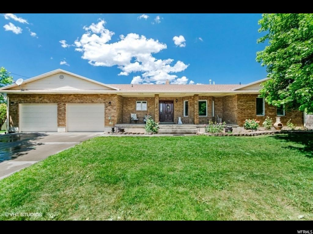 Beautiful custom Rambler on .37 acres in Fairview, UT.  3570 Sq ft, home is 100% finished. This house is in a very nice neighborhood.  Close to schools, churches, parks, gas stations, restaurants, and the mountains. It has 6 bedrooms, upgraded bathroom counter top and faucet, and a laundry room upstairs and downstairs. There is also a hair salon,  a HUGE garage, two covered patios, wood stove, separate basement entrance, shop/shed in backyard, sprinkler system, privacy slats in chain link fence, fully fenced backyard, 4 mature apple trees, 3 pear trees, mature maple trees around the property, low maintenance yard, RV parking and much more. Very well kept home.