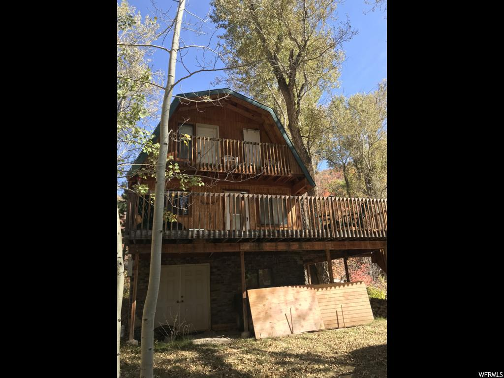 "Wow WOW WOW!! This is a fantastic cabin nestled right in the trees along a creek. This cabin has all that you need too have fun in the woods with your family and friends. Look at these amenities:  1000 gallon water tank, electric forced air heat, electric water heater, washer/dryer, vaulted ceiling, nice wrap around deck (approx. 10' X 28"" and 8' X 26') in size, basement is framed for more bedrooms or family room. River front with cascading waters over boulders and super views of the stream and water sounds from the cabin and decks. There are trout in the stream and great views of the mountains.  Access in the winter is by snowmobile or ATV but a lot of fun in the winter. Upstairs jetted tub is not hooked up but can be done in the future. Some furniture stays with the cabin. Square footage is provided as courtesy estimate only and are taken from county records. Buyers is advised to obtain own independent measurement.  Come take a look!"