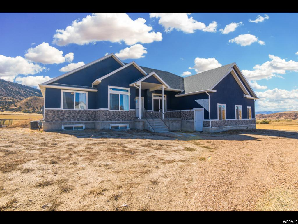 DON'T MISS THIS OPPORTUNITY TO OWN A BRAND NEW RAMBLER/RANCH HOME IN STERLING UTAH! NEW BUILD WITHOUT THE HUGE WAIT IS HARD TO COME BY, AND THIS HOME HAS ALL THE BELLS AND WHISTLES. HALF ACRE LOT PROVIDES PLENTY OF SPACE FOR TOYS, FAMILY AND FUN! TAKE ADVANTAGE OF THE OPEN COUNTRY AND AMAZING VIEWS OFF THE COVERED EXTERIOR DECK. GORGEOUS GRANITE COUNTERS THROUGHOUT, OPEN FLOOR PLAN, CUSTOM CABINETS, UPGRADES, UPGRADES, UPGRADES. MASSIVE WINDOWS AND VAULTED CEILINGS CREATE A LIGHT AND OPEN ENERGY WHEN WALKING THROUGH THE PROPERTY. SOME OF THE EXTRAS INCLUDE; 3-CAR EXTRA HEIGHT GARAGE, GAS FIREPLACE, ADDITIONAL WOOD BURNING FIREPLACE, TANK-LESS WATER-HEATER, WATER SOFTENER, BBQ PLUMBED WITH GAS, ELECTRIC RUN ON ROOF FOR CHRISTMAS LIGHTS OR OTHER, LARGE COLD STORAGE. THE LIST TRULY DOES GO ON! SCHEDULE AN APPOINTMENT TODAY! *All footage and measurements are deemed reliable but not guaranteed. Buyer is advised to obtain their own measurements.