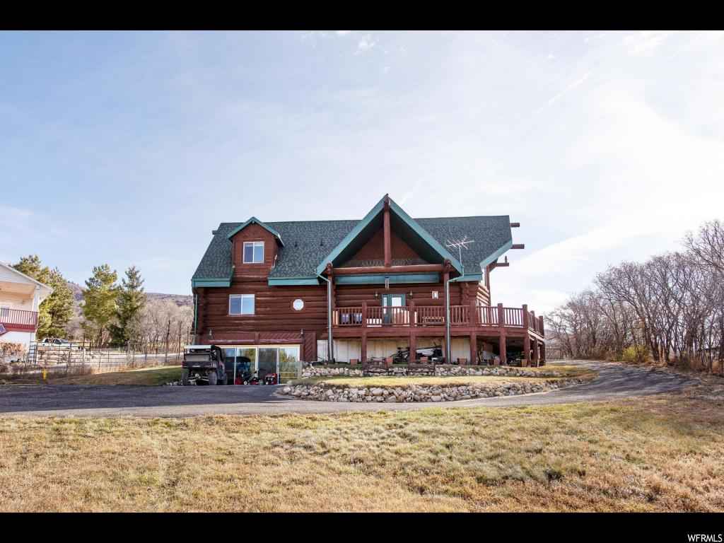 Clean custom log home nestled on 1.15 acres in quiet Fairview, Utah...situated on the east bench and offering amazing views! This wonderful opportunity is accessible year round allowing it to be your full time residence or a second home, and providing you with those needed summer getaways or a peaceful/cozy winter retreat! The quality wood interior also offers vaulted ceilings, massive windows for natural light, stone fireplace, main floor master suite, 2 family rooms, and an upstairs loft area for an office and the family sleepovers. The walkout basement has loads of storage and a negotiable swim spa and hot tub, enclosed in a glass sliding door. If you are looking for a place to get out of the city, traffic and smog...this is the home for you!