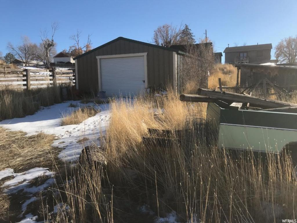 BUILDING LOT IN MORONI..existing 22'x30' metal building/garage and a couple of additional outbuildings; pedestrian access along the back. PERFECT LOCATION with a view!!  Square footage figures are provided as a courtesy estimate only and were obtained from Sanpete County.  Buyer is advised to obtain an independent measurement.