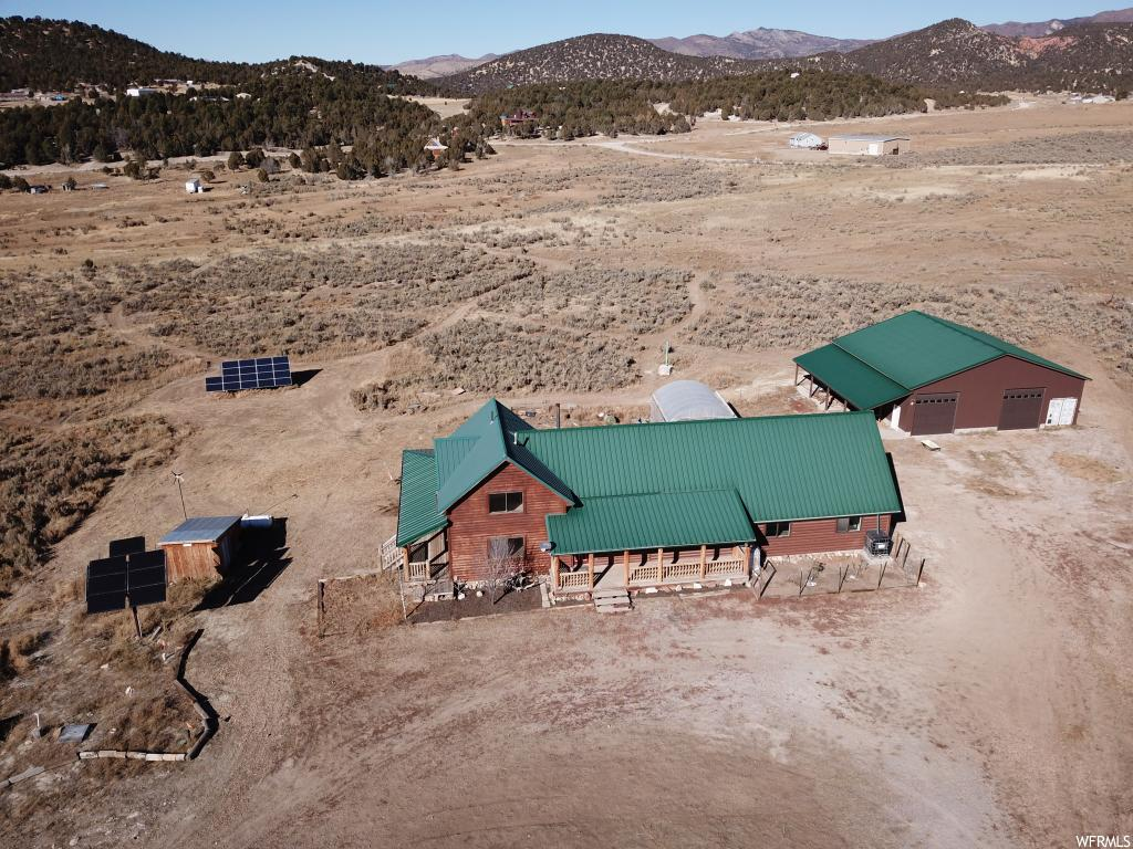 REDUCED PRICE Firm. Off-grid like new home on 5 acres with SUPER HUGE shop/garage, wrap-around deck and a view of the mountains.   ***** $5,000 carpet/flooring allowance included. Will also include side by side with full price offer!*****  30 minutes from Spanish Fork and only 10 minutes from the National Forest and Brown's Peak road up to Skyline Drive. No trailering of your ATV's needed to get to 350 miles of trails. Did you see the loft with the wood tongue and groove walls, ceiling and pellet stove?  The 40'x50' detached garage/shop with 3 LAEGE tall rollup doors makes one side a drive-through. This does not count the 50' long carport or the 8'x40' fully enclosed shipping container. Now that is SUPER HUGE! The basement has 2 large unfinished rooms for a theater room, family room, more bedrooms or whatever you want. Furniture, washer & dryer are negotiable. The greenhouse & gardens get water from the rainwater collection system. The remodel was completed in 2017 and in 2018 a New $40,000 solar system with new batteries and new Generac generator were added. All professionally maintained. The well was re-drilled about 2016 and is pumped with its own solar system into a 1,200-gallon holding tank. Sewer is a septic system and gas is propane from a tank you own. Year-round access with a car. MLS map is correct and Google Earth or Maps is 39.766371, -111.460243   Buyer to verify ALL information.