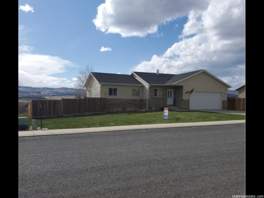 This home is a must see. Charming fully finished home at the gateway to Skyline drive. Great mountain view from the front porch. Fully fenced back yard with 6 foot fencing as well as 2 man gates to access the back yard. Rv parking on the side. Open living/kitchen concept with a formal dining room. Large master bedroom with walk-in shower. Nice bright family room in basement with fireplace inserts ready to add a fireplace if desired. New flooring throughout home. Water heater is 2 years old. Front yard is fully landscaped. Back yard gets to be finished to your desire. Perfect for your dogs as it has a doggie door from the house to the garage and straight out to the backyard. Square footage figures are provided as a courtesy estimate only and were obtained from Sanpete County.  Buyer is advised to obtain an independent measurement.