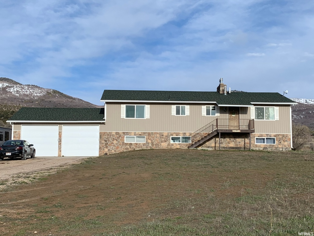 Price reduced!  This property offers beautiful views of the mountains that you can admire from the spacious back deck. Nestled in a small town not far from shopping in Spanish Fork. The home provides a spacious floor plan with a big living room that's great for social gatherings and entertaining. There are a large garage and a laundry room with lots of storage space. No need to maintain the road as the county provides those services. Sale includes 39 shares of Cottonwood Gooseberry, more shares are available for purchase if interested, culinary water comes from spring.