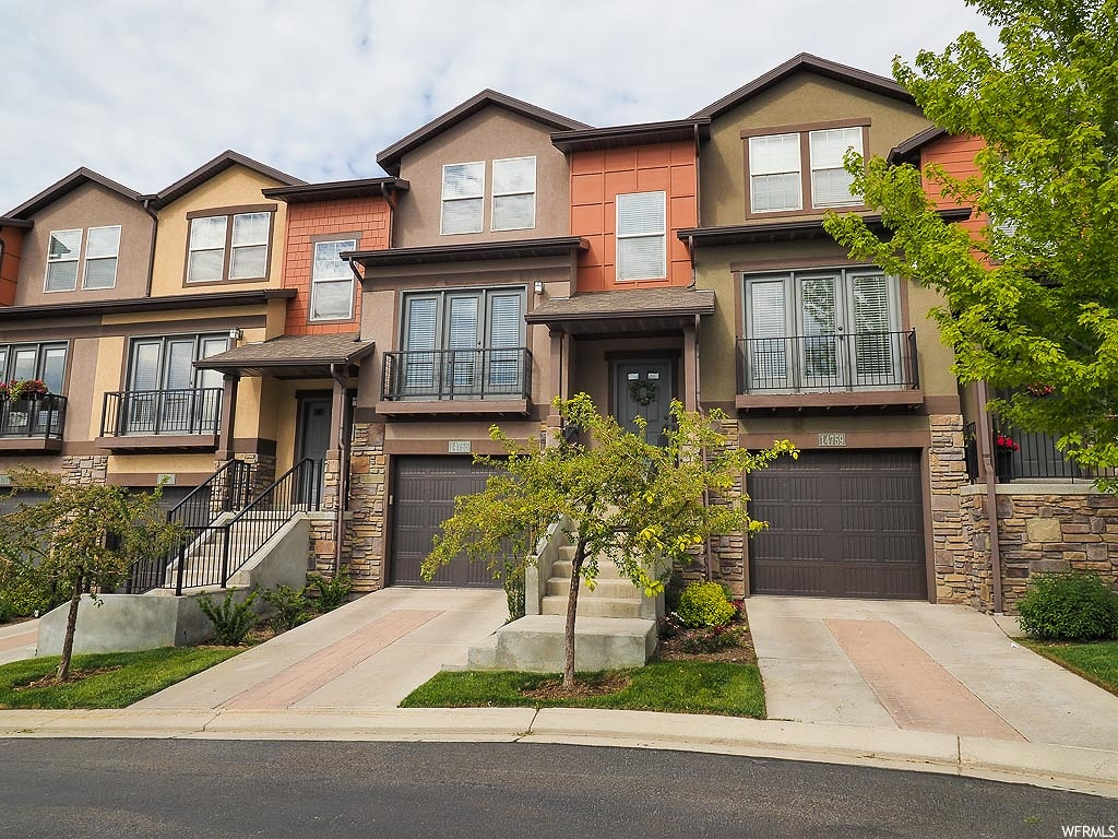 OPEN HOUSE: Saturday MAY 30TH FROM 11-2PM! THIS IS THE ONE!! Don't miss out on this East Draper mountainside gem located near endless trails and just minutes from I-15.The spacious living room features large picture windows with lots of natural light and a balcony where you can enjoy the gorgeous views of the valley. Head on over to the kitchen where you will find rustic cabinetry, stainless steel appliances,and a dining area fit for family gatherings. Continue up the stairs to a guest suite and the grand master bedroom, both accompanied by high ceilings and attached full bathrooms.Enjoy the beautiful Utah weather on the quaint back patio while hosting summer BBQ's with your friends. You cannot beat the location with the private trails that are pet, kid and bike friendly. They link all three communities along the bench and connect to the Flight Park. Your also a short walk or drive to Porter Rockwell and Corner Canyon trails. AGENTS - READ AGENT REMARKS BEFORE SUBMITTING AN OFFER.