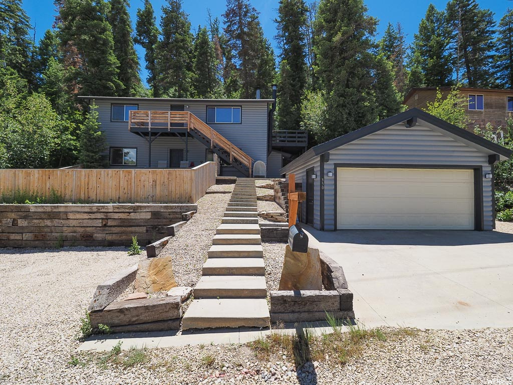 """GREAT INVESTMENT OPPORTUNITY! This is a single-family home in the heart of Park City that great investment opportunity with both an upstairs and downstairs unit that are available to rent if desired. Rents have been $1550-$1700 per unit! Or, if you would rather turn this stunner into one unit, the stair case to connect the units is under the false floor. Downstairs is equipped with a fully-furnished kitchen, one full bathroom, and two extra bedrooms. Here, the den offers a great location for cozying up to a wood-burning fireplace in those cold, winter months. Head upstairs and you'll enter a rustic living room with REAL wood floors and a wood-burning stove, perfect for any mountain retreat. Head into the kitchen and you'll find a wide kitchen with plenty of storage and counter space. The dining area features a fun chalkboard wall that is perfect for kids, as well as access to the wide-open deck off the side of the house. The two spacious bedrooms provide great views to the lush vegetation around the mountainous property. Don't like yard work? No worries! This house's landscape consists solely of gravel. There is plenty of foliage around the home to offer you that """"mountain get-away"""" look you've been waiting for! AGENTS - READ AGENT REMARKS BEFORE SUBMITTING AN OFFER."""