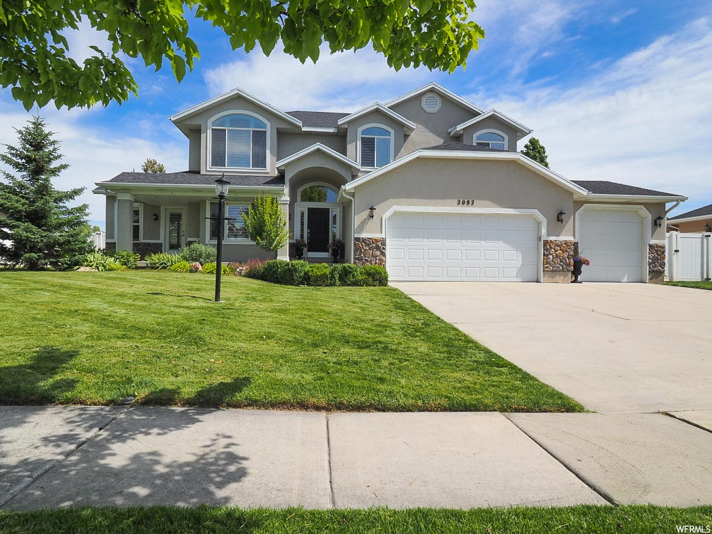MULTIPLE OFFERS RECEIVED! HIGHEST AND BEST DUE THURSDAY, JUNE 18TH AT NOON. This beautiful home located in the heart of Riverton has everything you could possibly need or want in a home. You will fall in love the moment you walk through the front door into the grand entryway with a welcoming formal living room with lots of natural light. The spacious great room comes complete with an elegant fireplace, large picture windows and convenient access to the stunning backyard. The kitchen features real hardwood floors, granite counter tops, stainless steel appliances and spacious formal dining room. The huge master bedroom is a true retreat with a walk-in closet and an updated master bath with double sinks and a beautiful shower and separate jetted tub. The laundry room is conveniently located on the second floor along with the three additional bedrooms and full bathroom. The fully finished basement offers even more living space with one finished bedroom, a three quarter bath, a den, a spacious area to enjoy a cozy movie night and a play nook perfect for entertaining the kids. Outside, you can relax and unwind all summer long on the patio where you can entertain all of your guests. Located near shopping, dining, parks, schools and so much more, this is one home you must come and see for yourself! AGENTS - READ AGENT REMARKS BEFORE SUBMITTING AN OFFER.