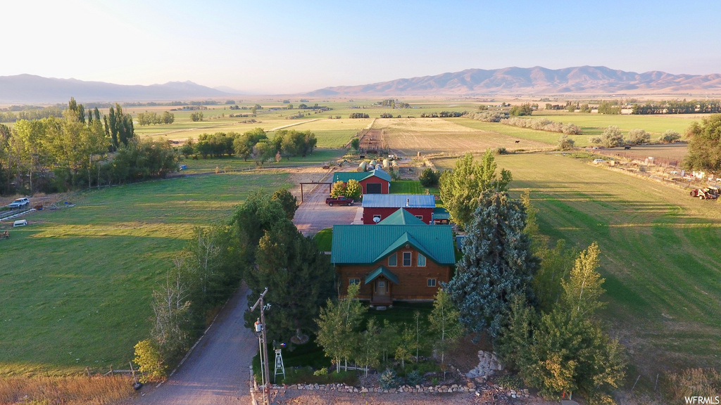 Wonderful, custom log home on a working cattle ranchette. This property is turnkey for anyone looking to have just under 50 acres of irrigated land for farming or animals. Here, the setup is perfect. Just a few miles NW of Malad, ID, and just off the maintained asphalt road, you find this home surrounded by a yard and at the forefront of its 48 acres. Fine detail went into the woodwork of this home to build it well, build it right, and finish it beautifully. All of the essential living is on the main floor and a third bedroom could easily be added in the loft. Just behind the home is a heated shop big enough for vehicles, tools, or toys, followed by two more enclosed shops with cement floors. Just beyond the buildings lies the connections to the piped and pressurized water system for The St. John Irrigating Company as well as the corrals and chutes. The farm is currently split into three pastures with some cross fencing to include oats, pasture grasses, and alfalfa. The watering system is currently made up of flood irrigation, and pods. With the water shares being more than enough, you could easily convert this to an irrigation system. This rare setup is a one of a kind property. Call us today to schedule an appointment.