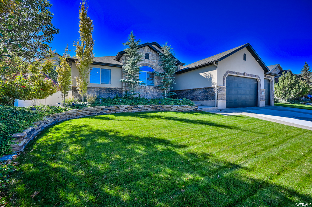 Fabulous home located in quiet Herriman neighborhood with many custom upgrades. Enjoy the open concept floor plan. Kitchen has large island, granite countertops, recessed lighting, and tall cabinets. Primary bedroom features a cozy gas fireplace. Finished basement has 3 additional bedrooms, den, bathroom and large family room with storage space to spare. Fully-fenced private backyard with covered patio, perfect for entertaining. 3 car garage with the drive through 3rd bay to backyard (RV Parking). Well Maintained including new furnace and A/C. Check out the video tour and 3D virtual tour!