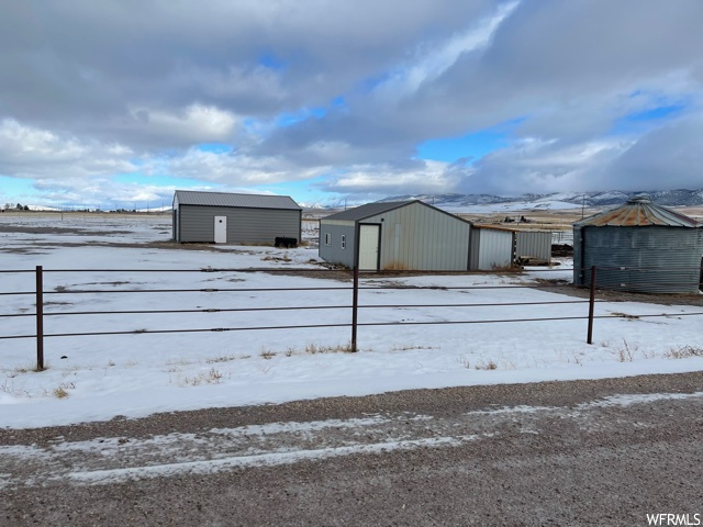 9.8 acres with 2 sheds (24x30) 24x21) and a well.  Property is fully fenced and used for pasture and hay.  Not irrigated.  Great place to build a home.  In Downey Idaho.