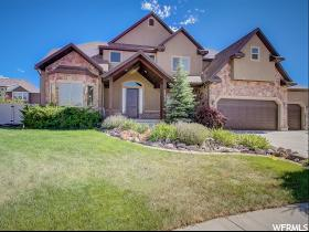 Home for sale at 6977 W Boulder Ridge Cir, Herriman, UT  84096. Listed at 600000 with 6 bedrooms, 4 bathrooms and 6,217 total square feet