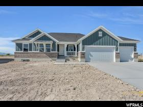 Home for sale at 874 W Sagewood Dr, Stansbury Park, UT 84074. Listed at 395900 with 3 bedrooms, 2 bathrooms and 3,168 total square feet