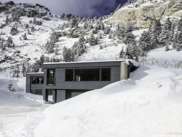 TURN KEY, SOLD FULLY FURNISHED!  Quintessential modern ALTA home on the sunny side of the creek, set up to ski, caretaker unit, access from bypass and hwy 210.   Call for a private showing.