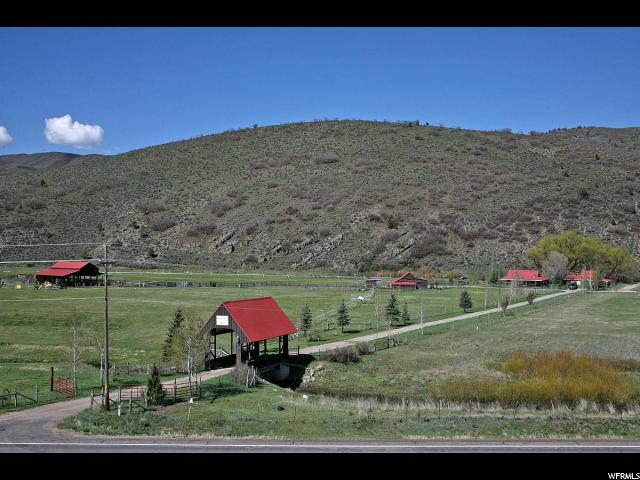 Incredible Family Retreat in Birdseye, Utah! Only 25 minutes from Spanish Fork.  Includes a covered bridge entry, 2 beautiful updated homes, workshop, huge hay barn, multiple sheds and outbuildings. (Sq. footage, bedrooms & baths include both houses.)  The smaller home is ideal for guests, mother-in-law, caretaker, or kids in transition.  This ranch features 2 amazing springs, 2 overflowing ponds & 2 streams!! Around the clock 24/7 pressurized irrigation system. This acreage is nearly all irrigated & includes 2 Big Guns, and many hand lines. 30 Large Animal Stock Watering Rights included. This has one of the best water rights in the entire valley! The soil is rich, black and virtually rock free. Borders Public Lands - the DNR & National Forest are your backyard playground. Close access to hiking, 4-wheeler, and horse trails. Lots of green pastures, riding corral & fencing. Ample area to park campers, trailers and RV's for your FAMILY REUNIONS! Backyard is a kid's paradise with the pond, swings & tree house.  Truly a Beautiful FAMILY RETREAT!  You won't be disappointed!
