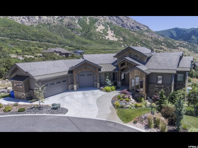 This 2015 Parade of Homes will have you in awe from the minute you drive in the driveway. Gorgeous landscape and Views in every direction surround this custom designed home. The Exterior boasts full set stone, aggregated rusted steel and concrete siding. Bartile roof and custom rain gutters finish the breathtaking exterior. Once you step inside the custom kitchen with quartz counters, high end Thermador appliances, induction range, dbl ovens and open pantry will have you wanting to entertain. Master suite with his and her sinks and walk in closets, full steam shower with built in tile lounger in shower, All bedrooms have a walk in closet and their own bathroom. Full sports bar with multiple TV's, 2 large booths and enough theater seating for at least 20! Did I mention the in ground pool w/diving board, pool shower and changing area w/ 2nd laundry room. Firepit, fully fenced and a suspended slab under the garage for all your toys. You will LOVE it!!!