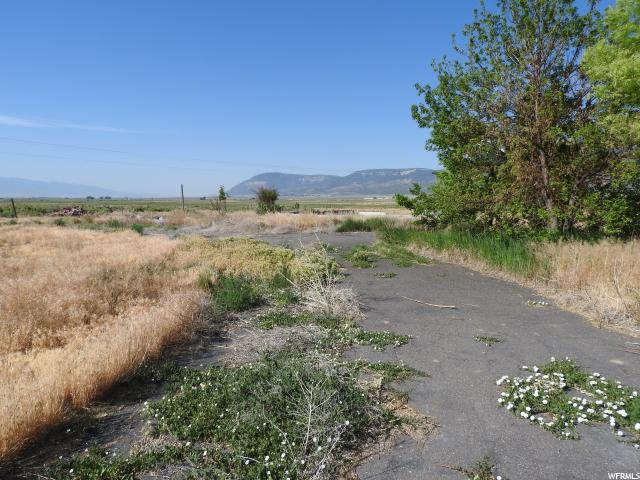 Price reduced! Includes tax id #: 25215X2  Excellent location with the potential for a home site with septic system in place. Beautiful views of the valley & mountain ranges and highway access on both east & north side of the subject site, sales price includes 5 shares of M & M Irrigation water. Just north of Moroni city limits on Hwy 132.There is a culinary well already on the property, but a buyer would have to apply to the State of Utah/Division of Water rights to have water right reinstated for existing culinary well. Buyer to verify all information.