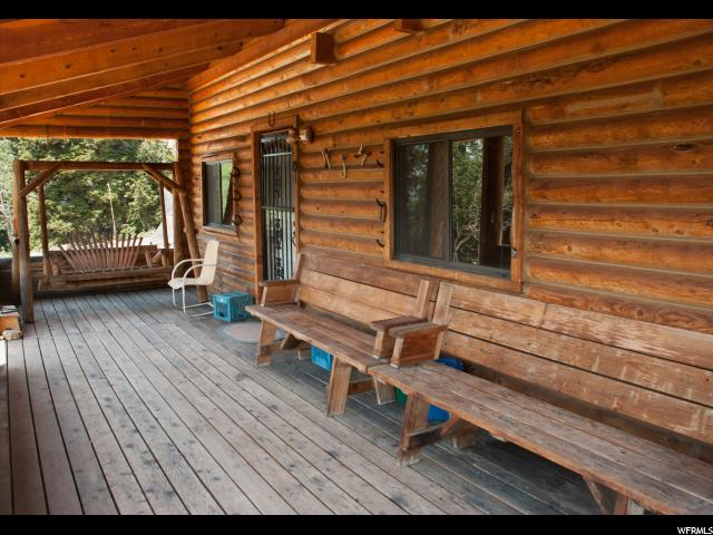 40 Acres in 10 acre lot parcels to be sold together.  One cabin with Propane, generator, septic and  2 springs, one spring runs to the home with pump to 2- 1,000 gallon tanks.  Great hunting preserve or family enclave possible. Secluded one of a kind property.  Estate sale!  Truly spectacular!!