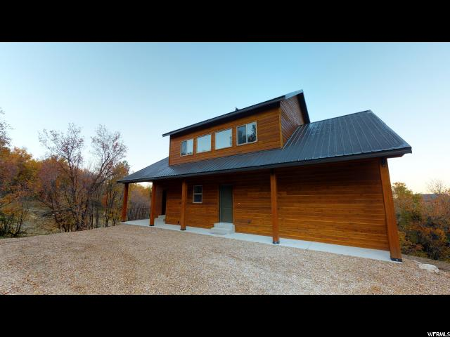 Brand New Cabin!  Absolutely Gorgeous Finishes and Solid Construction!  The Hollows subdivision is a gated mountain community where you will enjoy all of what the outdoors has to offer!  Hiking, Fishing nearby, ATV's and Snowmobiling in the Winter!  Come see it today!